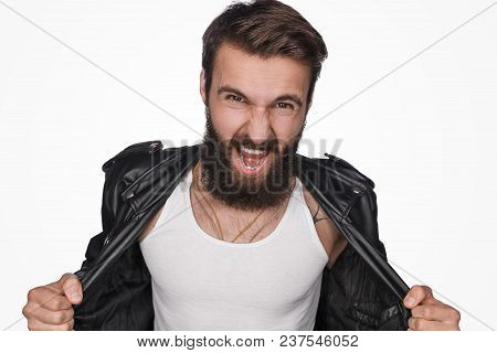 Bearded Macho Screaming At Camera Wearing Stylish Black Leather Jacket And Showing Chest Isolated On