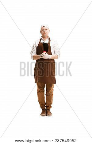 Smiling Butcher Posing With A Cleaver Isolated On White Studio Background. The Young Caucasian Male