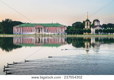 Aristocratic Mansion And Church With Bell Tower Next To The Palace Pond In Museum-estate Kuskovo, Su