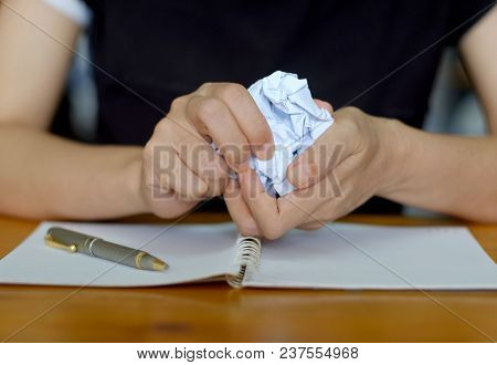 Hands Crumpling Paper After Mistake During Writing On Working Desk In The Office.