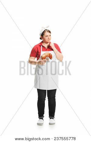 Portrait Of Cute Smiling Woman With Pastries In Her Hands In The Studio, Isolated On White Backgroun