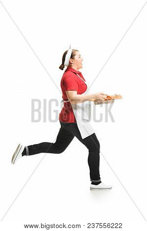 Portrait Of Cute Smiling Woman With Pastries In Her Hands In The Studio Running Isolated On White Ba