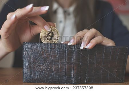 Successfully Woman Put A Bitcoin Into Wallet. Crypto Coin Saving. Savings Money. Blockchain Technolo
