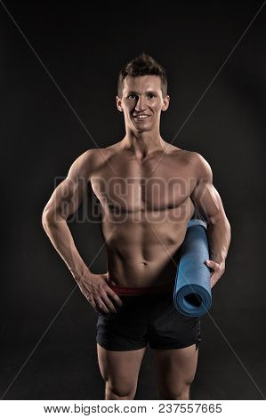 Happy Man Hold Yoga Mat. Sportsman Smile With Sexy Torso And Six Pack. Athlete Smiling With Strong A