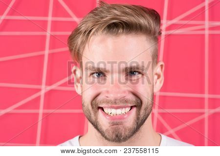 Happy Macho With Beard On Unshaven Face. Bearded Man Smile With Blond Hair And Stylish Haircut. Guy