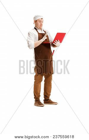 Surprised Butcher Posing With A Laptop Isolated On White Studio Background. The Young Caucasian Male