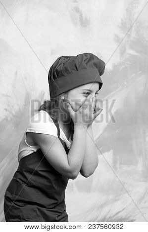 Cooking And Playing. Girl In Chef Hat And Apron. Child And Happy Childhood. Kid Cook Smiling On Colo