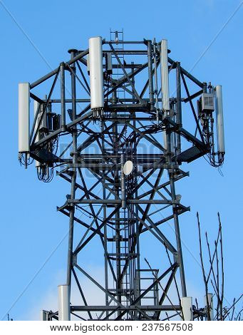 A Mobile Phone Mast Against A Blue Sky
