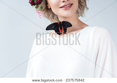 Cropped View Of Happy Girl With Beautiful Alive Butterfly On Neck, Isolated On Grey