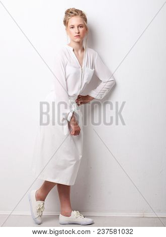 Portrait of a blond  girl over white background
