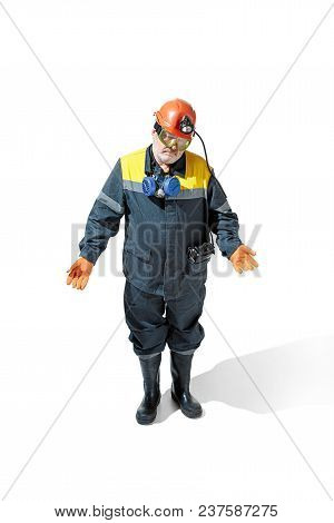 Studio Shot Of Sad Discouraged Senior Bearded Male Miner In Professional Helmet Standing At The Came