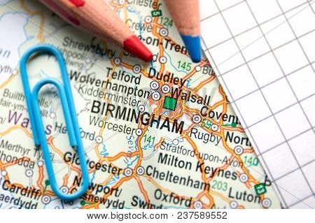 Birmingham City Of Great Britain In The Center Of The Geographic Map, Pencils And Paper Sheet