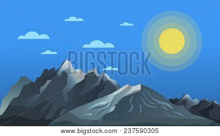 Mountaineering And Alpine Tourism Concept. Nature Landscape With Bright Sun And High Mountain Range.