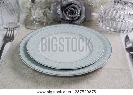 Table Arrangement For Dinner Party, Wedding Events. Plates, Cutlery And Decoration. The Mockup.