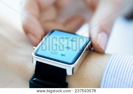 modern technology and people concept - close up of woman hands wearing smart watch with social media icons