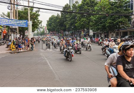 Ho Chi Minh, Vietnam-december 9, 2013. Crowd Of People Ride Motorcycle In Rush Hour And Streets Are