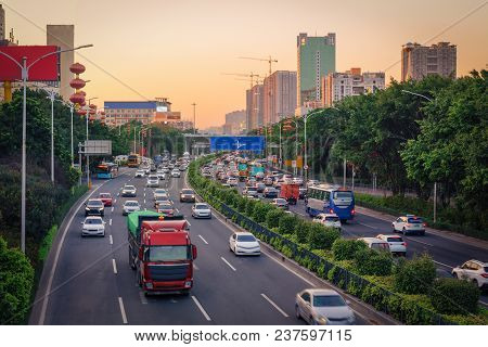 Evening Rush Hour In Big City, Traffic Jam From Many Cars On Divided Highway Road, Busy Urban View A