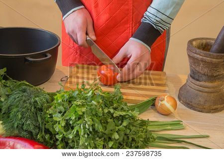 Male Hands Cutting Vegetables On Kitchen Blackboard. Healthy Food. Man Preparing Vegetables, Cooking