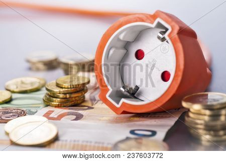 Socket With Several Euro Coins And Banknotes