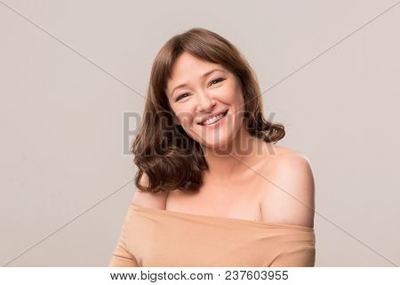 Beautiful Smiling Model With Shoulder Long Hair. Isolated On White Background. Mid Age Woman Over 35