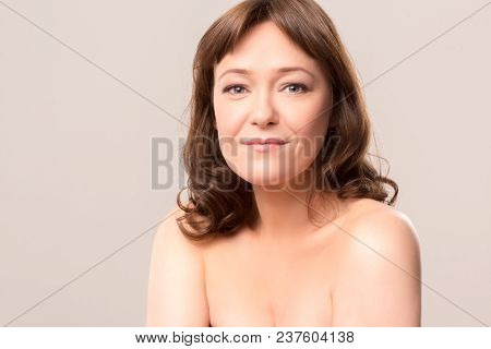 Half Length Image Of Beautiful Woman With Middle Length Hair. Beauty Concept. Mid Age Woman Over 35