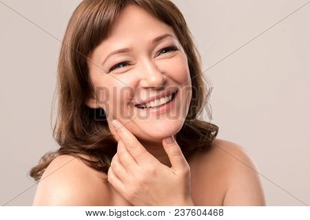 Close Up Portrait Of Charming Woman Smiling And Looking Aside. Isolated On White Background. Mid Age