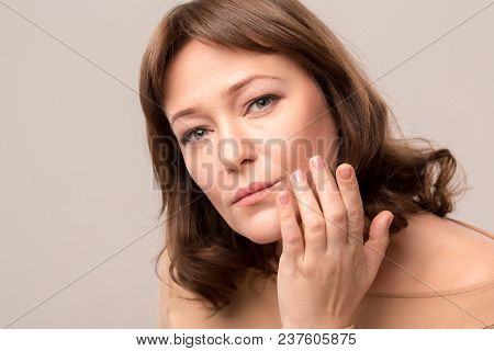 Close Up Portrait Of Awesome Woman Gently Touching Her Lips. Posing On Camera. Beauty Concept. Mid A
