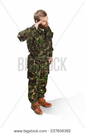 Young Army Soldier Wearing Camouflage Uniform Standing And Saluting Isolated On White Studio Backgro