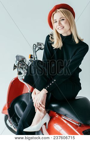 Stylish Pretty Woman In Red Beret Posing By Vintage Scooter Isolated On Grey