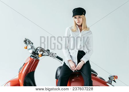 Attractive Young Woman Sitting On Vintage Motorcycle Isolated On Grey