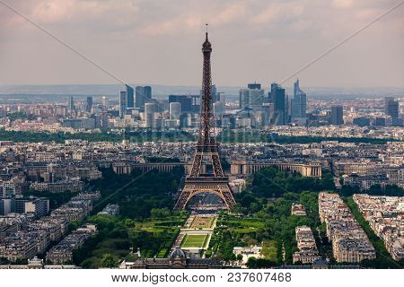 Aerial view of Eiffel Tower, Champ de Mars and La Defense district on background as seen from Montparnasse Tower in Paris, France.