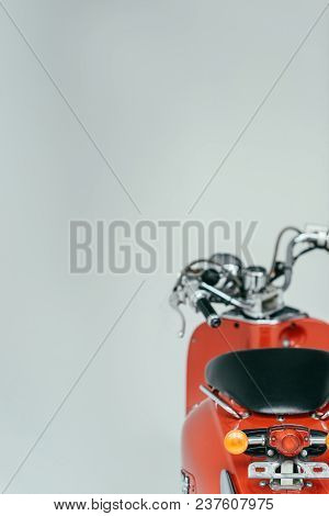 Red Retro Scooter Bike Isolated On Grey