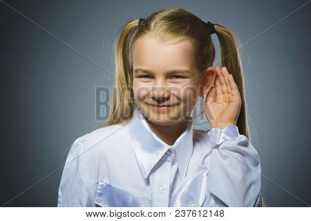 Curious Disappointed Girl Listens. Closeup Portrait Child Hearing Something, Parents Talk, Hand To E