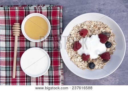 Breakfast Meal With A Bowl Of Muesli With Yogurt And Honey