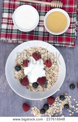 Vertical Image Of A Bowl Of Muesli With Yogurt And Honey