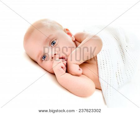 Portrait Of A Four Months Old Baby On White Background
