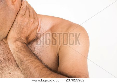 Closeup Unhappy Man Suffering From Neck Pain And Injury On White Background. Health Care And Medical
