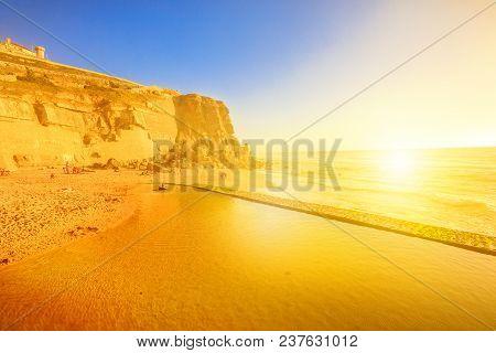 Azenhas Do Mar Beach At Sunlight, Atlantic Ocean In Portugal. Popular Portuguese Seaside Resort Near