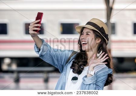 Selfie-portrait Of Attractive Girl With Long Hair Standing At Railway Station. She Is Smiling To The