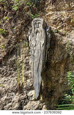 Historical Sculpture Made Of Wood In The Form Of An Old Man. Church And Religion