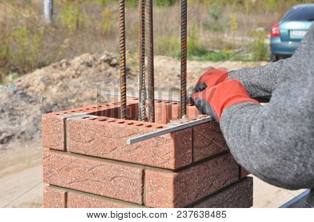 Closeup On Brick Laying Blocks Correctly On Fence Brick Column. Whether You Are Laying Brick To Buil