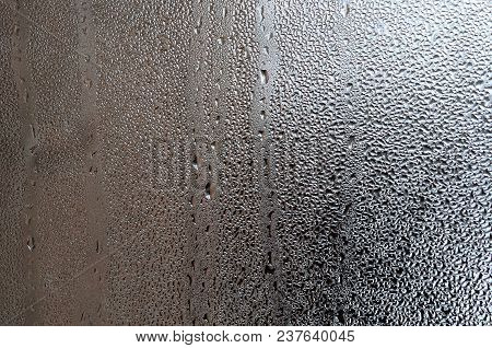 Texture Of A Drop Of Rain On A Glass Wet Transparent Background. Toned In Grey Color