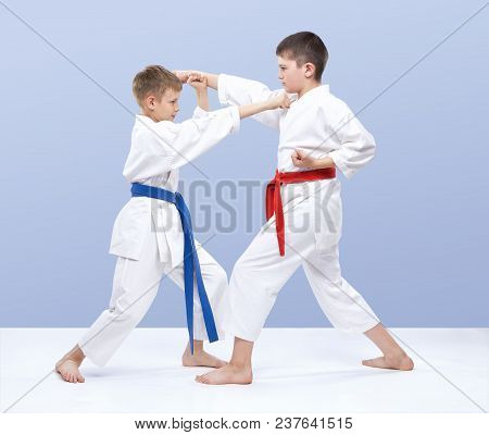 The Boys Are Training Strikes And Blocks Of Hands