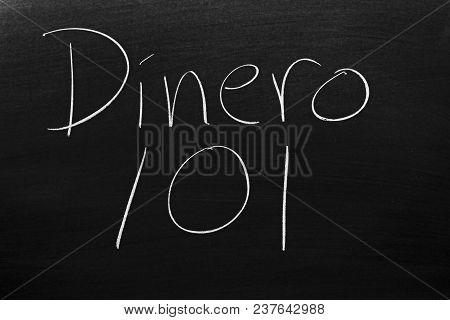 The Words Dinero 101 (money 101) On A Blackboard In Chalk