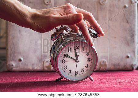 Hand Man Turns Off The Alarm Clock, Awakening From Sleep.