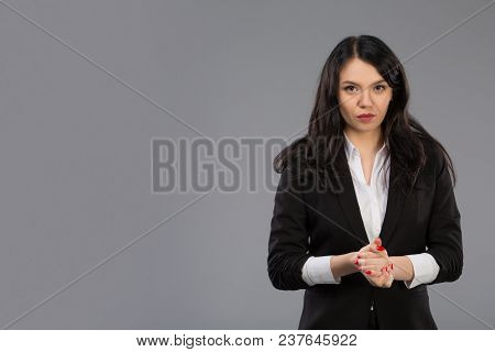 Portrait Of Stunning, Nice, Sexy Director In Eye Wear In Black Jacket Folded Finger To Finger With S