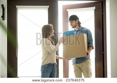 Smiling Courier Delivering Parcel To Young Woman, Happy Satisfied Customer Receiving Cardboard Box F