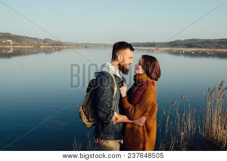 Romance And Rest. A Loving Couple Near A Blue Lake