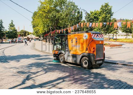 Editorial Image Of Street Janitor Using Cleaning Machine To Sweep And Clean Sidewalk Tile In Istanbu