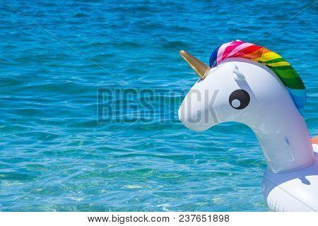 Unicorn Swim Tube On The Beach, Koh Lipe, Satun, Thailandinflatable Unicorn.fantasy Swim Ring For Su